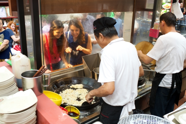 A hawker prepares mouth-watering street food in Singapore